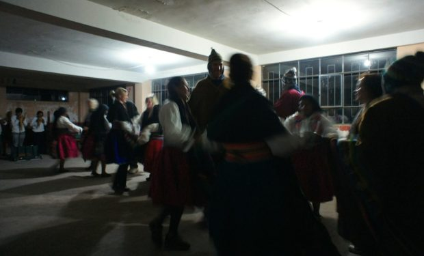 dancing in traditional Quechua clothes during a Lake Titicaca homestay
