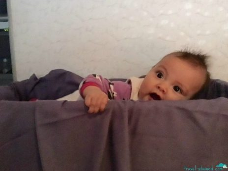 Trying to climb out of the bassinet