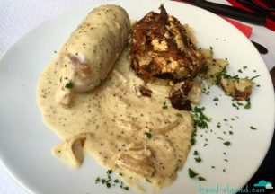 Andouillette lyonnaise sauce moutarde à l'ancienne au vin blanc (Tripes pork sausage with old fashionned Dijon mustard sauce)