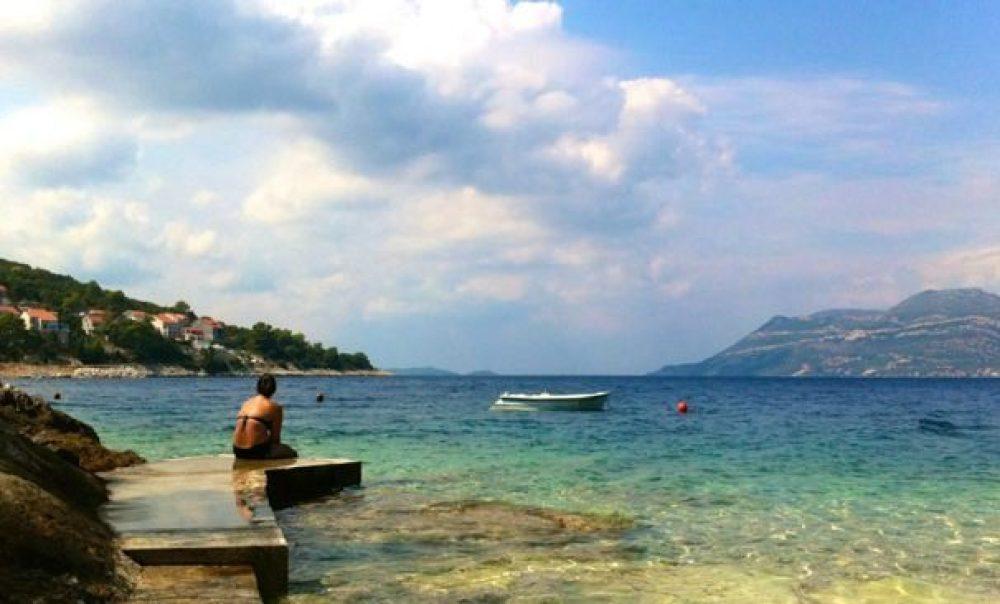 girl sitting on dock on badija island