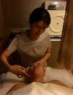 The first application of toner during a Korean facial.