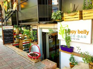 storefront of happy belly juice bar in tirana