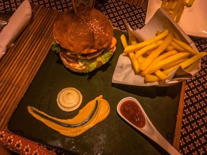 burger and fries at ten moons lipe resort on sunrise beach