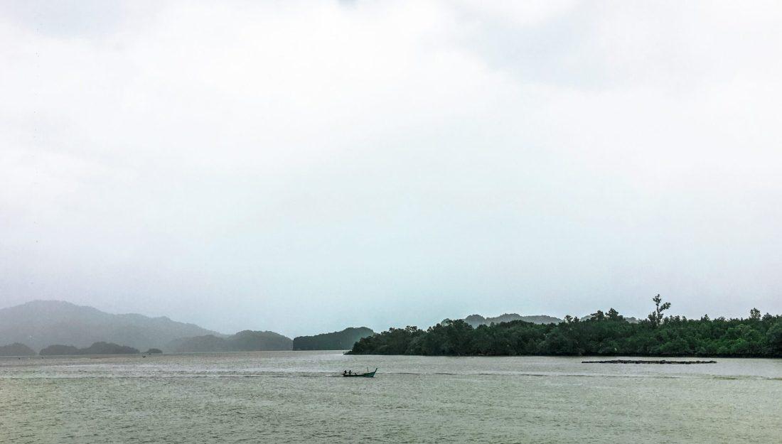 rainy skies over pak bara pier thailand