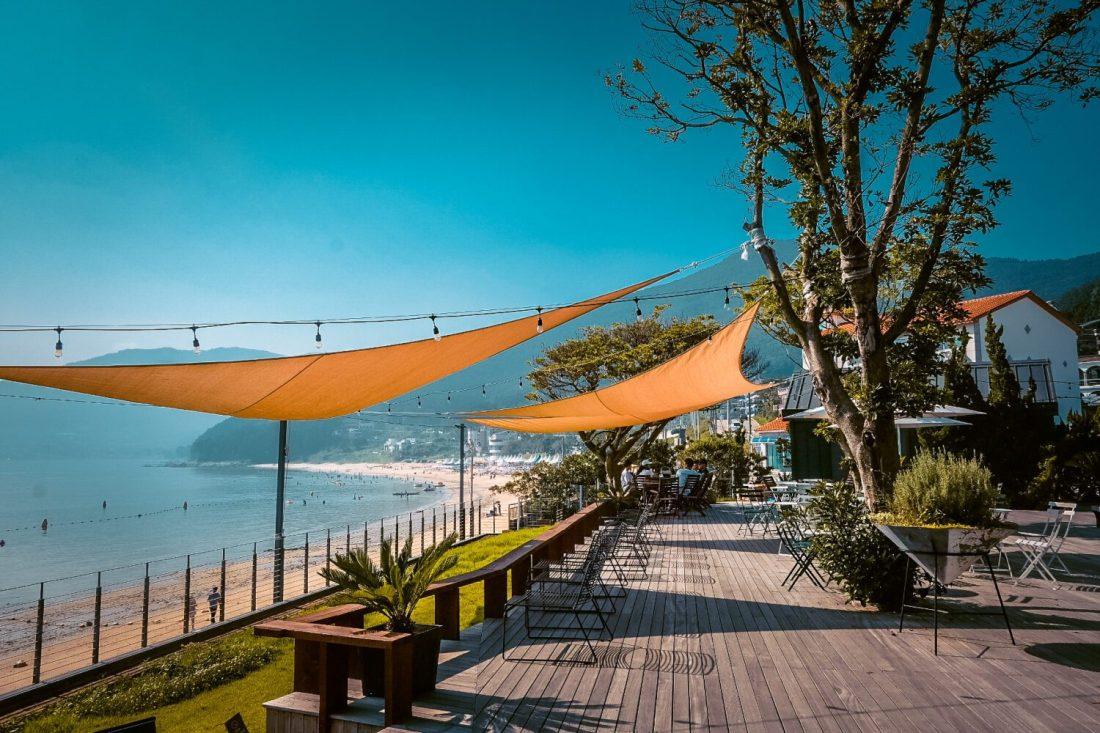 beaches in korea | view of gujora beach on geoje island from oedo nursery cafe