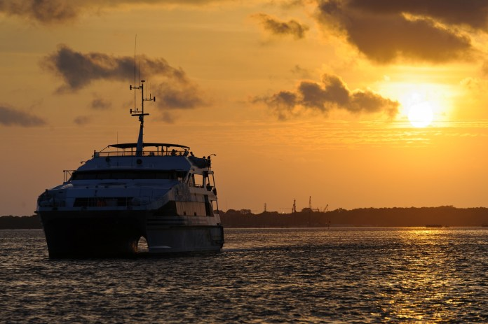 Combine a dramatic Balinese sunset with a sumptuous meal aboard a luxury sea-going vessel