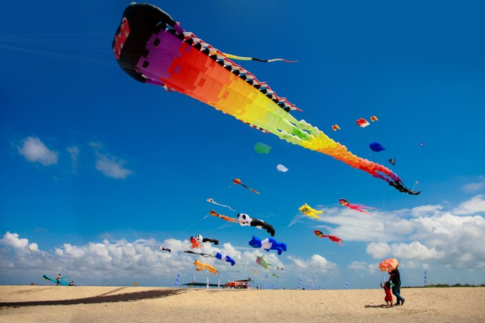 Witness hundreds of kites dancing in the sky above Sanur.