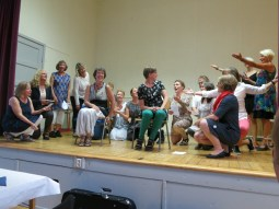 the singing class presents a song to their teachers