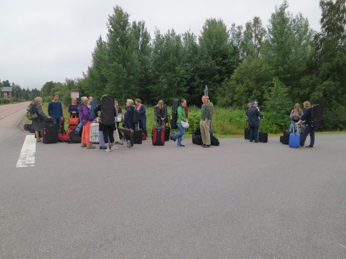 waiting for the bus. which seemed already full when it arrived, causing considerable consternation. but then we all fit after all.
