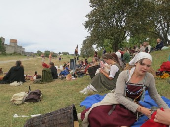the brännvinboll population: the young hip set, many/most of whom seem to have made their own garb, some of whom are working their sewing handwork while they watch the game