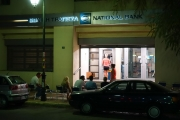 <h5>Waiting for their turn for cash</h5><p>1 in the morning, waiting in queue to withdraw 50 euros. Greece, 2015. Why?</p>