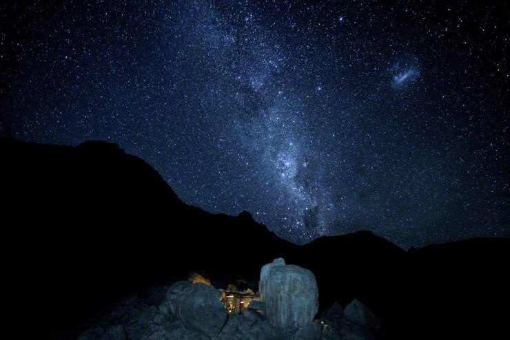 The Milky Way rises over our home built into the rocks at the Gondwana Collection Klein-Aus Vista.