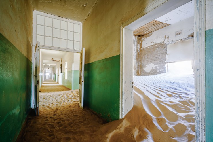 The Kolmanskop Ghost Town provides an eerie backdrop for early morning photography.