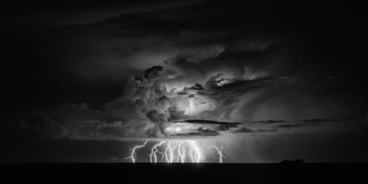 A distant thunderstorm rumbles and throws down tons of bolts west of the small community of Wilaha in northern Arizona.