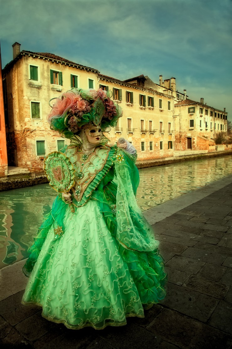 Green costumed Carnival model on Burano Island in Venice