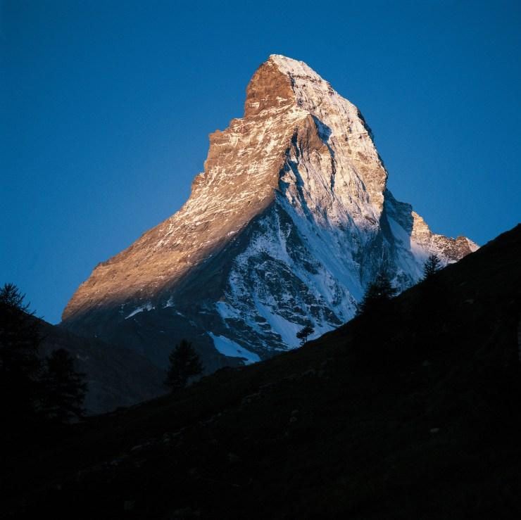 Your holiday. Switzerland. - Mountains Zermatt (1616 m) in Valais. View from Hubel (1946 m) above Zmutt on the 4478 m-high Matterhorn. Endlich Ferien. Ihre Schweiz. - Berge Zermatt (1616 m) im Wallis. Blick vom Hubel (1946 m) oberhalb Zmutt auf das 4478 m hohe Matterhorn. Enfin les vacances. A vous la Suisse. - Montagnes Zermatt (1616 m) en Valais. Vue depuis Hubel (1946 m) au-dessus de Zmutt sur le Cervin (4478 m). Copyright by Switzerland Tourism By-line: swiss-image.ch/Lucia Degonda