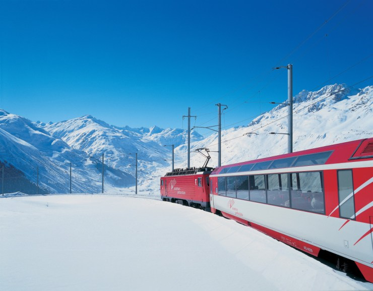Switzerland. get natural. A train of the Matterhorn Gotthard Bahn (MGB) on the Oberalp Pass at an elevation of roughly 1900 m. Schweiz. ganz natuerlich. Ein Zug der Matterhorn Gotthard Bahn (MGB) am Oberalppass auf rund 1900 m. Suisse. tout naturellement. Un train du Matterhorn Gotthard Bahn (MGB) au col de l'Oberalp a environ 1900 m. Copyright by: Schweiz Tourismus By-Line: swiss-image.ch/Christof Sonderegger