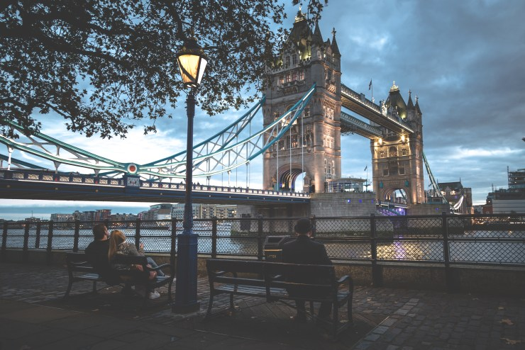 The Bowler Man sits and stares at his favourite place, Tower Bridge. It brings great delight to him to watch the sun go down as the lights on the bridge illuminate. The Bowler Man may be alone, but he is content with his life and happy to see others that are enjoying this moment as well.