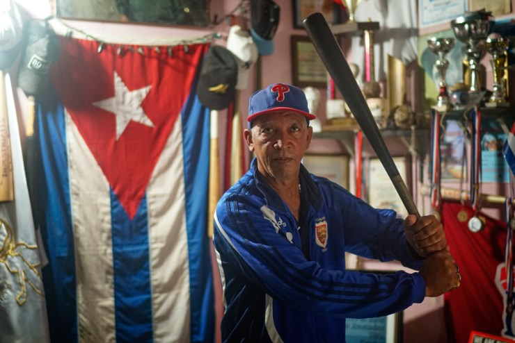 Jose Luis Bos Rodriguez has turned his home into a baseball museum, celebrating the rich history of the sport in Cuba. Photographed with a Tamron 35mm f/1.8 at 1/40 seconds.