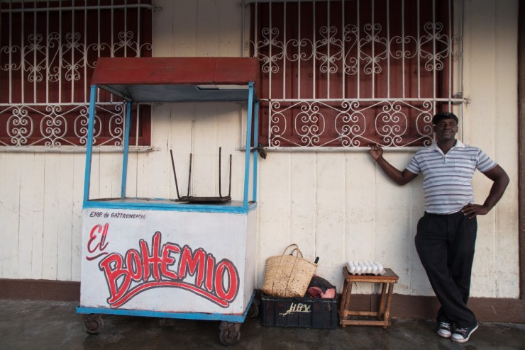 The owner of the food cart El Bohemio packs up after a full day selling food on the streets of Ciefo De Avila. Photographed on a Tamron 24-70 f/2.8 at 1/80 seconds and f/2.8.