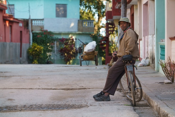 A man sits on his bike in the early morning hours in Sancti Spiritus. Photographed with a Tamron 70-200 at 1/80 and f/5.