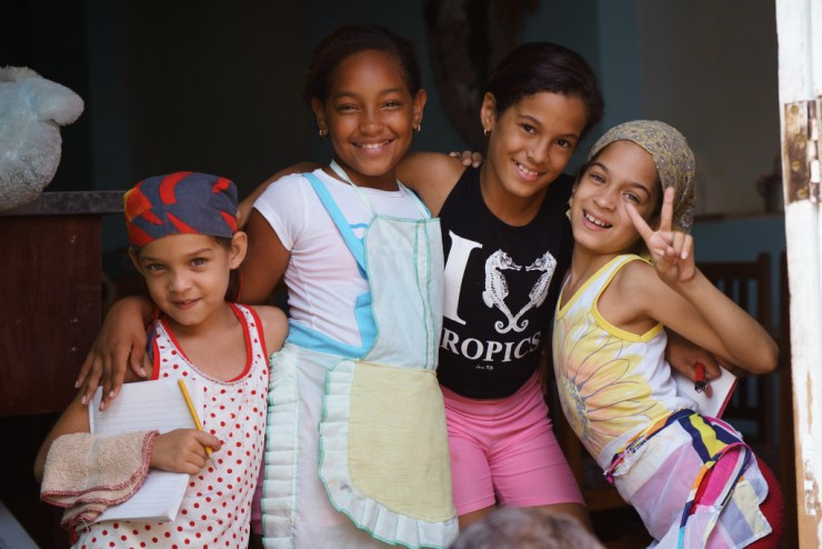 Girls pose for a photo in a home in Holguin. Photographed with a Tamron 24-70 f/2.8 at 1/250, f/2.8.