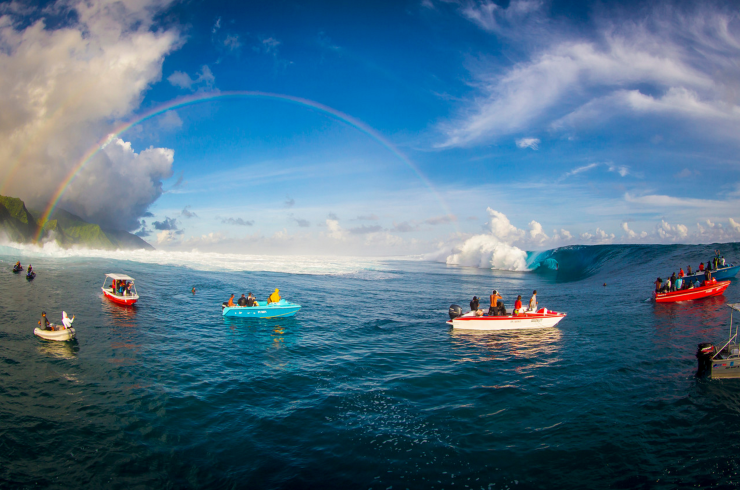 A rainbow over the frequented surfed breaks in Tahiti. Photo by Ben Thouard.