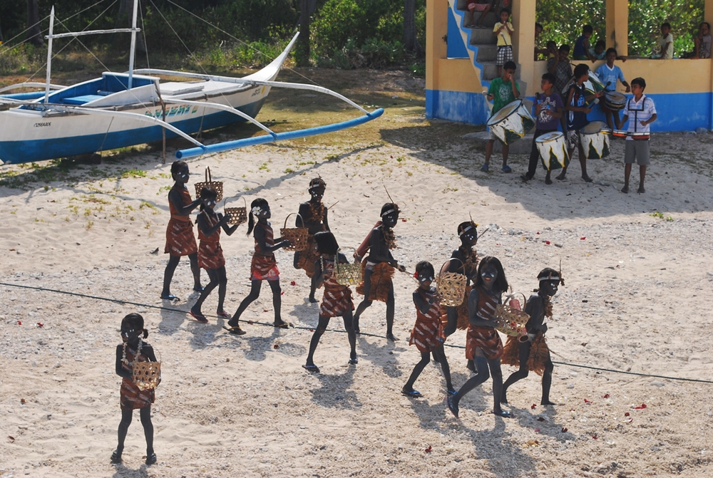 and experience local island culture such as this festival held at Cobrador Island in Romblon © nomadicexperiences.com