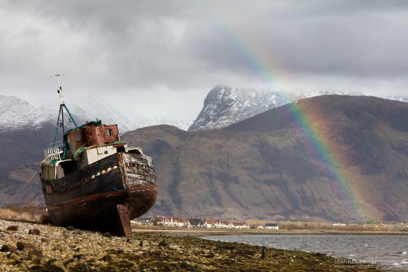 Shipwreck on Corpach Beach in front of Ben Nevis.  It was raining where I was but the sun came out and prodcuced a vibrant rainbow.
