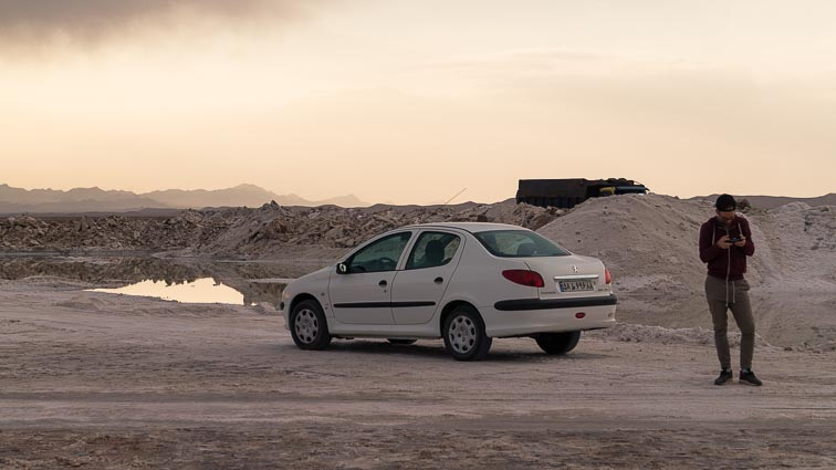 Renting a car in Iran. Car rental Iran. Traffic in Iran. our Peugeot 206 near a salt lake near Varzaneh