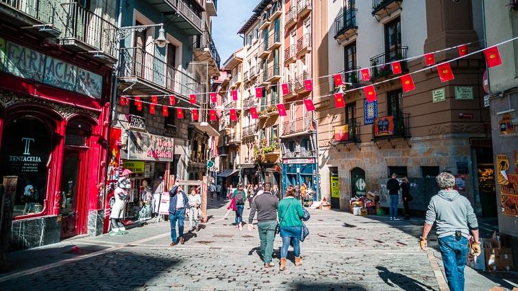 Locals roam the streets in Pamplona
