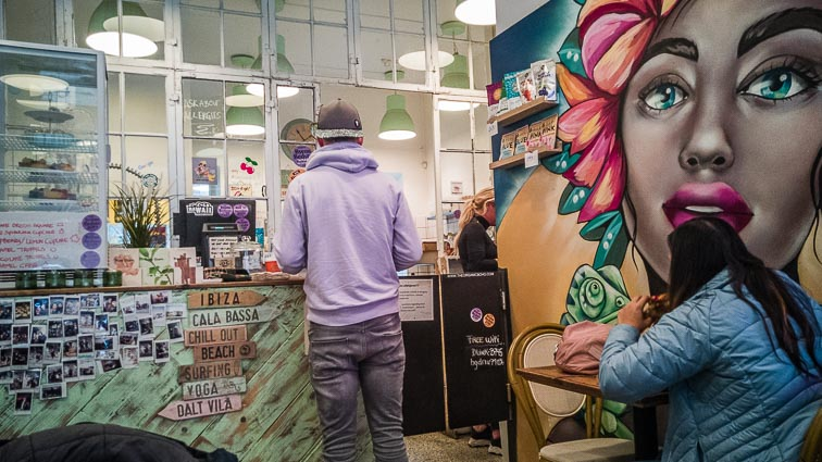 Erick standing at the counter of The Organic Boho. The best bars and restaurants in Copenhagen