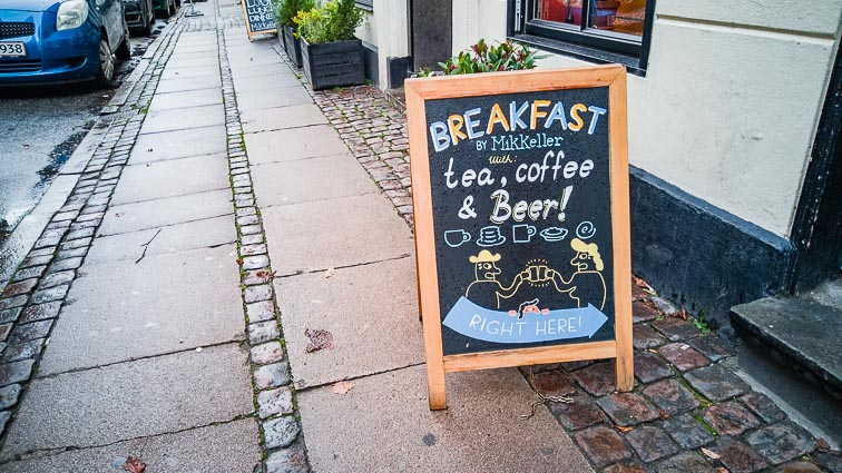 "Sign outside the Mikkeller bar in Vesterbro: ""Breakfast, tea, coffe & beer"". The best bars and restaurants in Copenhagen"