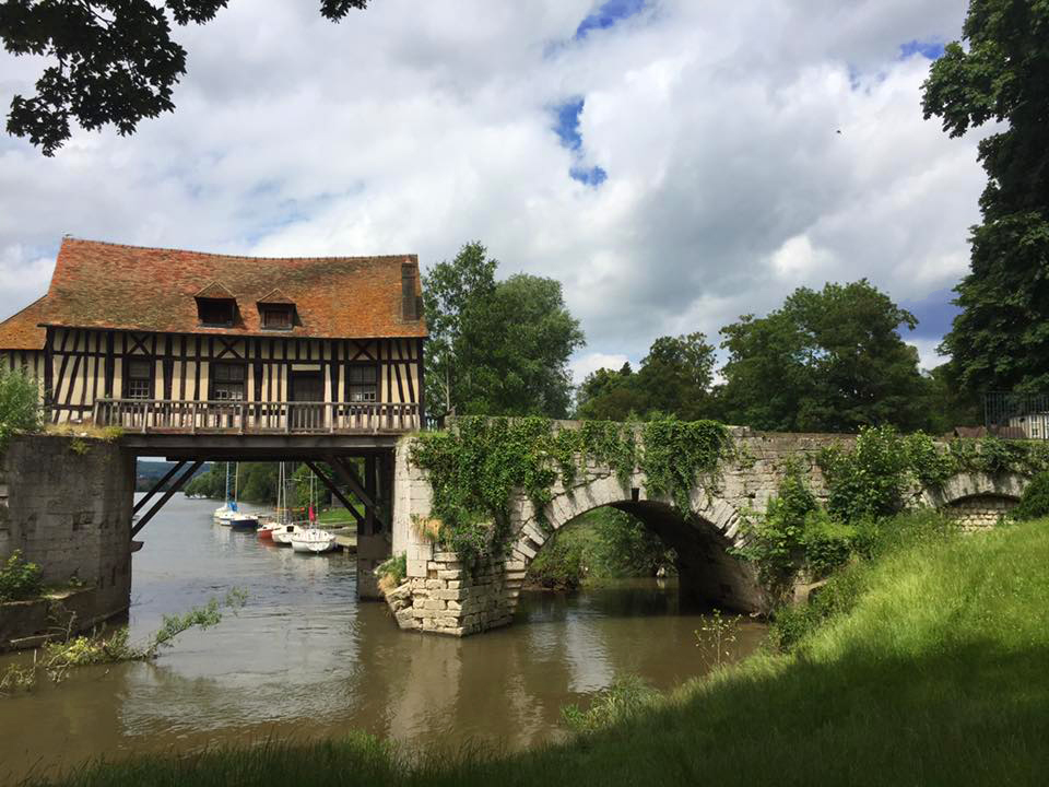 bridge and mill over a river