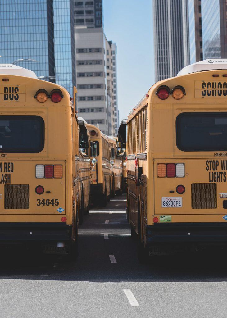 school buses on busy street