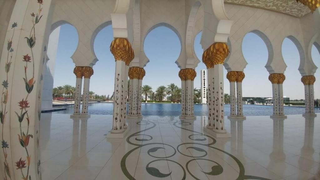 columns. reflective pool, mosque