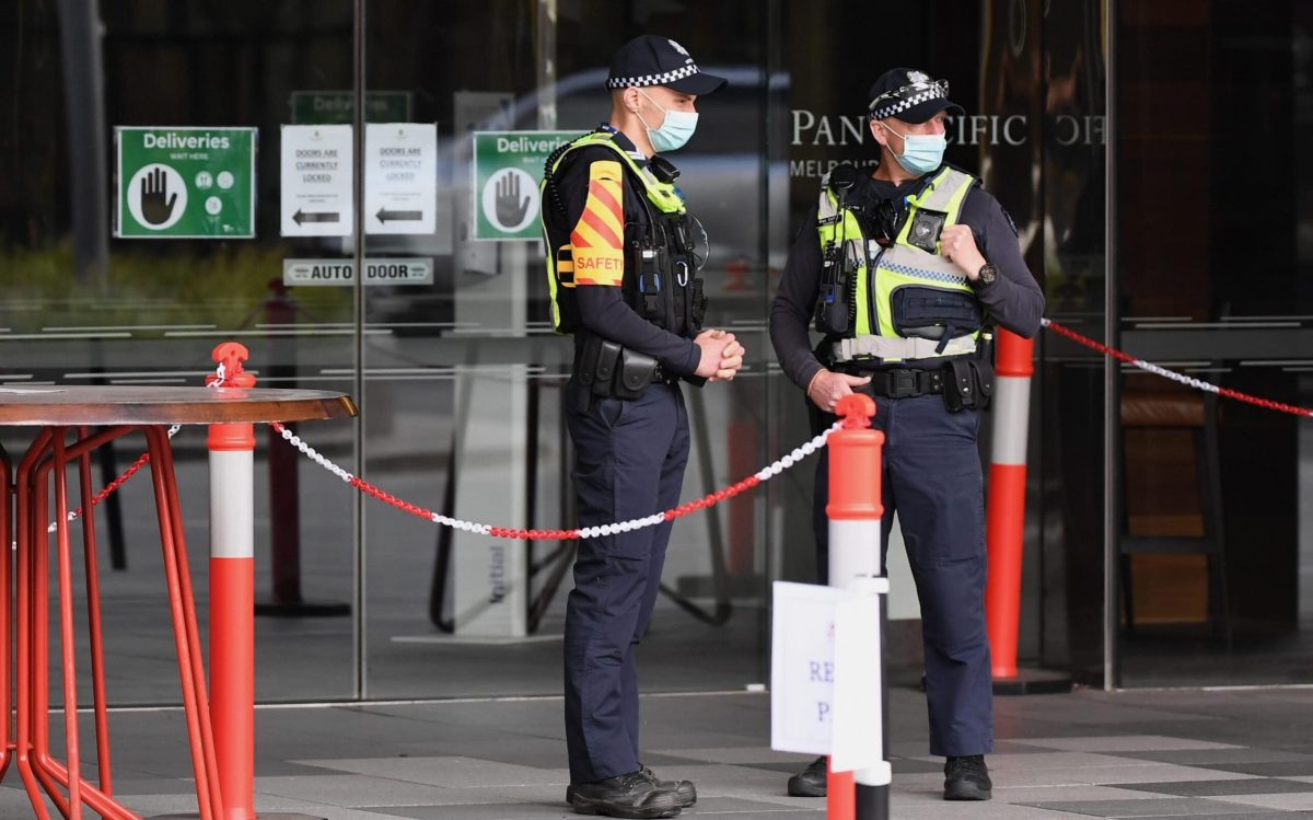 Police outside a quarantine hotel in Melbourne, Australia