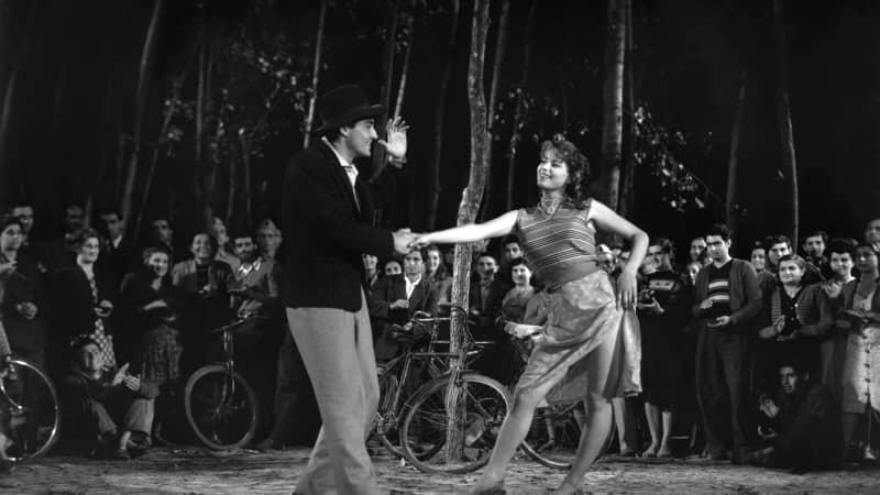 """Silvana Mangano with Vittorio Gassman in """"Riso Amaro."""""""