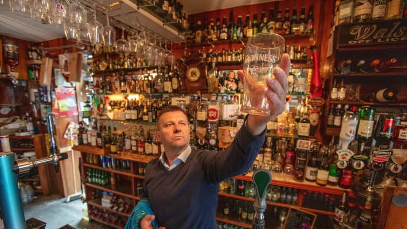 Publican Joe Sheridan poses for a photograph in his closed pub, Walsh's bar, in the rural village of Dunmore in the west of Ireland, on September 3, 2020.