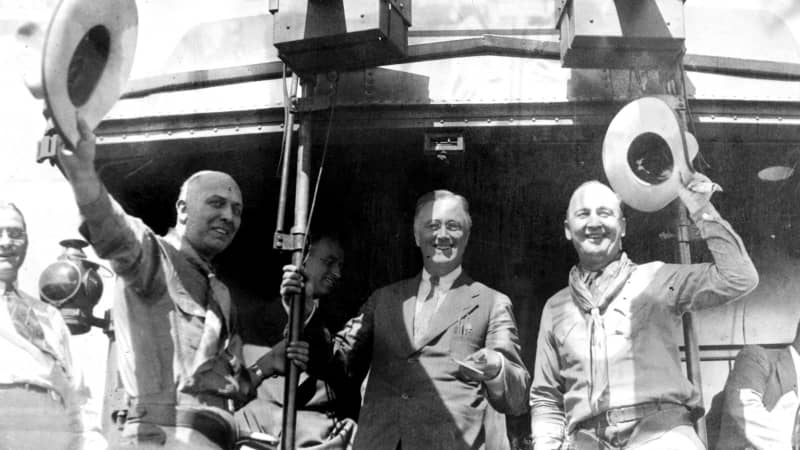 Two cowboys join Franklin D. Roosevelt during an electioneering tour in 1932.