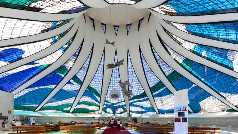 The Cathedral of Brasilia and its suspended angels are bathed with natural light shining through the stained glass.