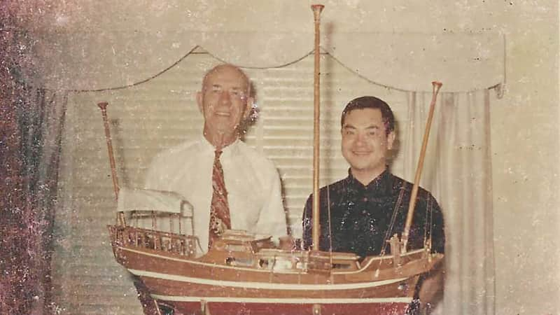 """Treadwell and Fong stand with the model of """"Little Duck."""""""