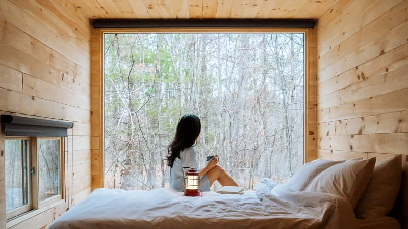 A window onto the woods is each Getaway cabin's defining feature. Some cabins have queen bunks.