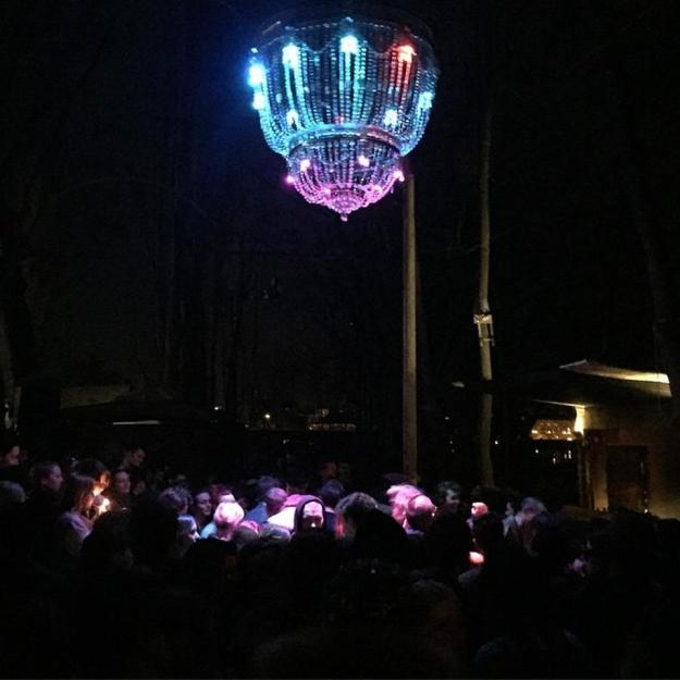 Outdoor stage with a giant chandelier. Source: Foursquare