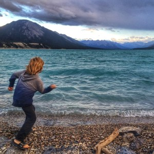 Finn skipping rocks on Lake Abraham