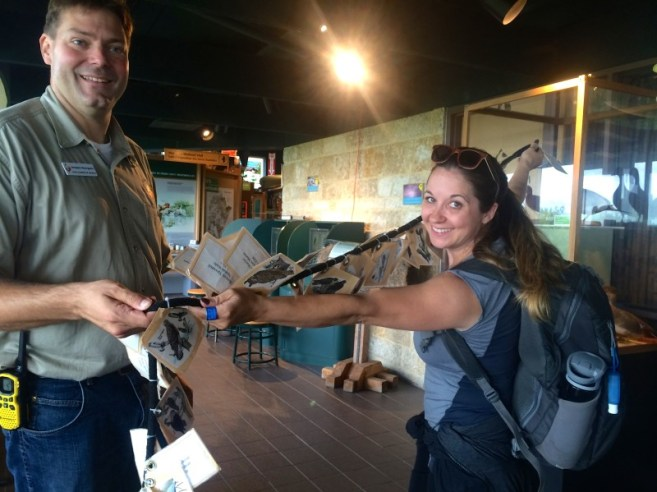 Jenn Smith Nelson getting her wingspan measured at Oak Hammock Marsh