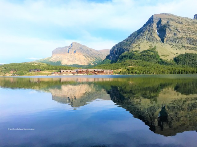 Amazing view of Mountain Reflections in to the Crystal clear water of Swiftcurrent Lake