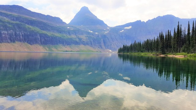 Reflection of Mountains in to Clear water of Hidden Lake