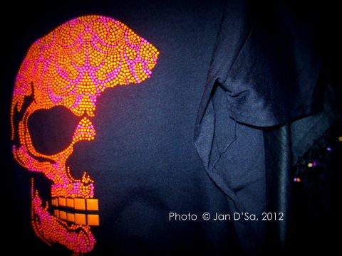 Half a skull makes a bold statement on a black T Shirt.