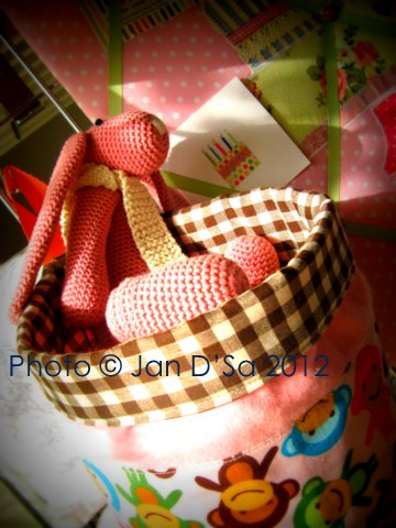 Terhi Karpinnen's crochet bunny is happily seated in the All Things Bright basket
